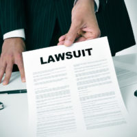 lawsuit delivered by lawyer in office