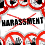 Sign that reads harassment