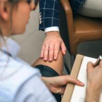 Boss sexual harassing blonde secretary by touching leg
