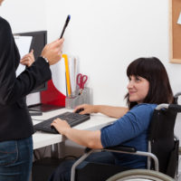 Disabled woman in wheelchair at work