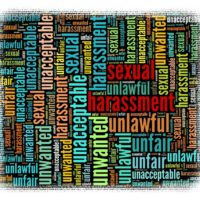 Colorful Sexual Harassment sign