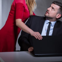 Female boss harrassing male employee