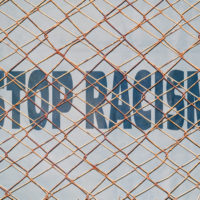 Fence that has stop racism sign