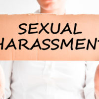 Pink sign sexual harassment