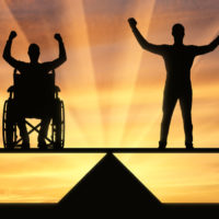 diable man in wheelchair and a man standing