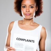 woman holding complaints form