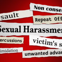 the red Sexual Harassment sign