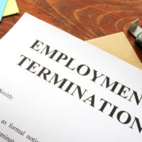Employment termination letter on desk with office supplies