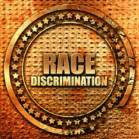 badge that reads race discrimination