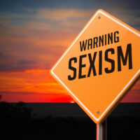 warning sexism Road Sign against sunset