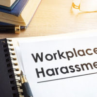 notepad that reads workplace harassment