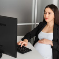 pregnant woman working in the office