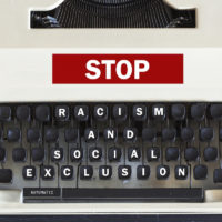 Retro typewriter with message stop racism and social exclusion message written on it
