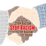 Stop racism written as part of handshake illustration