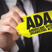 yellow ADA sign