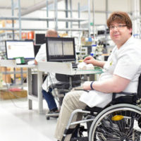 Image of individual in wheelchair - often experiencing disability harassment