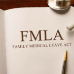 Page in FMLA book on the table with stethoscope and pencil on table