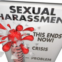 white sexual harassment sign