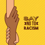 "Yellow sign that reads ""say no to racism"" in an effort to bring awareness towards the sad reality of racial discrimination that occurs in workplace"