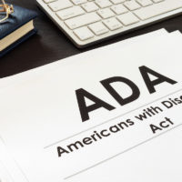 ADA documents, glasses, keyboard on desk