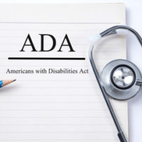 Binder that reads ADA (American Disabilities Act)