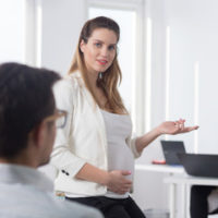Pregnant employee facing discrimination in the workplace