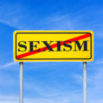 Yellow sign that reads sexism