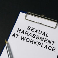 Clipboard that reads sexual harassment at workplace
