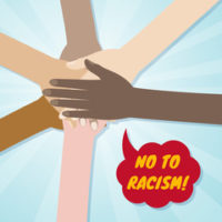 All hands with sign that reads no to racisim