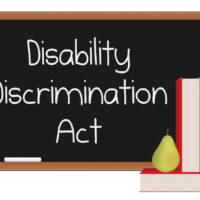 Chalkboard with the words Disability Discrimination Act
