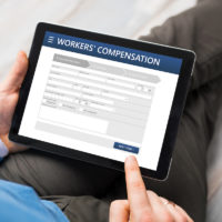 man filing workers' compensation on iPad