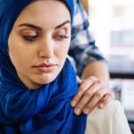Muslim woman touched at work by coworker