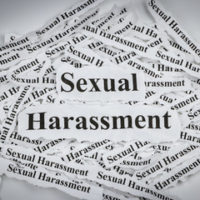 Pieces of paper that read sexual harassment