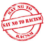 Say no to racism rubber stamped in red