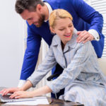 Boss touching female in sexual manner