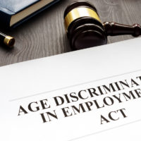 Age Discrimination in Employment Act and gavel in a court.