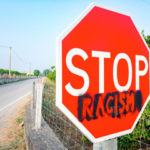 The sign thats on the street stop racism