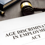 White document that reads age discrimination in employment act