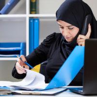 Muslim office worker on phone