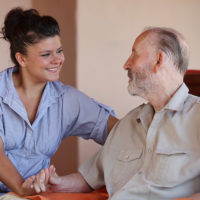 home health aide taking care of grandparent