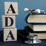 ADA (American Disabilities Act) in block letters with stethoscope and books