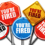 multiple varied road signs reading you're fired