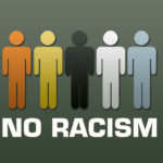 different color cutout human symbol with caption no racism
