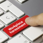 red key reads workplace harassment