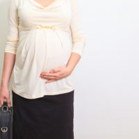 pregnant businesswoman getting ready to go to work