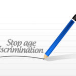 pencil writes stop age discrimination on notepad