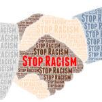 Stop racism words shaped in handshake