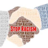 Stop racism words shaped in handshake