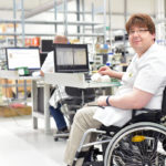 disabled employee working in workplace