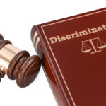 Discrimination book with gavel